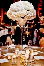 stylish wedding centerpiece in martini glass filed with pearls