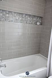 bathroom with bathtub and gray subway tile shower surround niche or alcove in hexagon marble tile greige accent tile kylie m interiors design bathroom h13