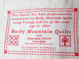 Antique Quilt Restoration and Quilt Repair & Image of the Rocky Mountain Quilts Label. Reads: This textile has been  professionally restored ... Adamdwight.com