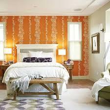 orange wallpaper and white bedding