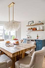 rectangular capiz chandelier over reclaimed wood dining table