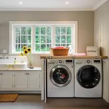 Under counter washer dryer Lacetothetop Washer And Dryer Cabinet With Fold In Doors Decorpad Washer Dryer Next To Sink Design Ideas