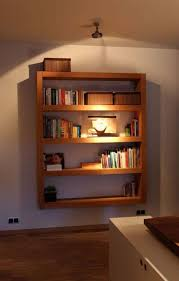 i really like the design of this bookshelf it reminds me of the children s bookshelf i showed earlier in this post it is great because it hangs on a wall