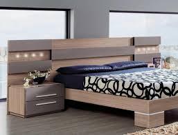 bedroom furniture modern design. Contemporary Bedroom White Bedding Brown Wooden Sled Frame Bed Furniture Modern Design