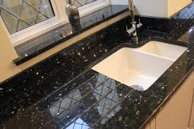 Granite Kitchen Work Tops Emerald Pearl Granite Worktops Against Green Kitchen Cabinets With