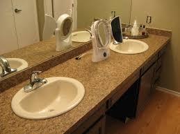 bathroom ideas granite countertop mounted washbasin mirror backsplash tile black small vanity storage drawers ceramic flooring
