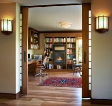 view in gallery elaborate home office with sliding glass doors that tuck away into the wall