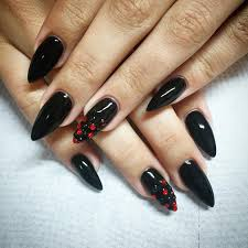 black and red pointy nail art