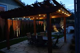lighting for pergolas. Meticulous Landscaping In The Front And Backyards, But Also Transform Their Classic Pergola With Elegant Lighting For Night Time, Outdoor Entertaining. Pergolas