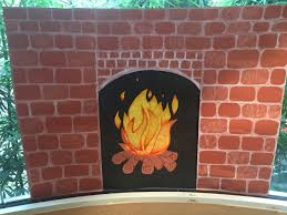 Construction paper fireplace I made for our kindergarten classroom window.