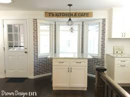 for this space i also made a faux brick wall window trim and a large pallet sign