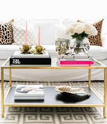 nothing says hi i ve arrived like a couple of stylish coffee table books sitting pretty on your you guessed it coffee table