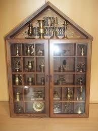 vintage wooden wall cabinet filled