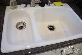 how to clean a porcelain sink even hard water stains and black scuff marks