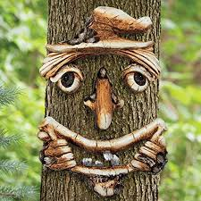 bits and pieces scarecrow tree face yard art outdoor tree hugger sculpture garden decoration