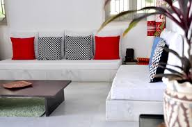white fabric low base floor seating couch with colorful cushions also espresso rectangle coffee table informal living areas