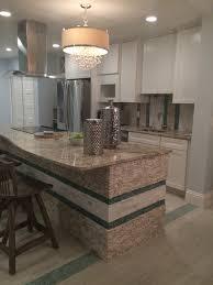 standing quartz pebble tile kitchen island and backsplash
