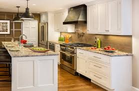 kitchen with white inset shaker cabinets long stainless bar pulls metal range hood and