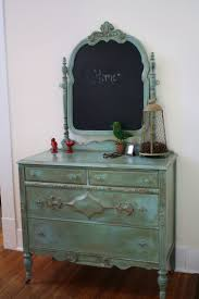 Antique dresser - mirror flipped and painted with chalkboard paint. Perfect  foyer/mudroom piece