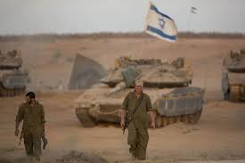 i gaza war report defends idf actions fingers hamas the i iers seen at a deployment area near the border the gaza strip on