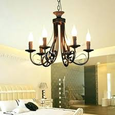 pillar candle chandelier dining room contemporary with area rug baseboards centerpiece restoration hardware rectangular full size