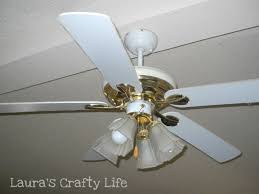 you see it when you are looking from the kitchen and there it hangs with all its ugly brassiness just mocking me with how ugly it is ceiling fans ugly