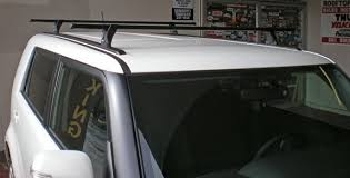 this is a custom 2010 scion xb roof rack system featuring an adjule bar spread and 165lb carrying capacity rack toronto