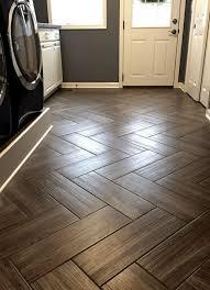 mudroom flooring gray wood grain tile in herringbone pattern a sugared life