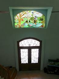 stained glass window above front door