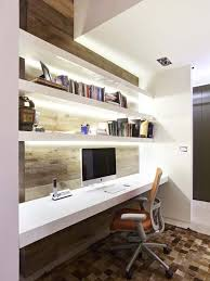 an ultra modern workspace with lit up floating shelves and a desk for comfy working