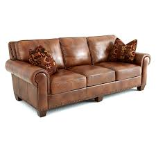 furniture light brown leather sofa with there seat also cushions plus short brown wooden legs