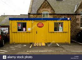 office in container. Post Office In Yellow Portacabin Container Building, Coldingham, Scotland H