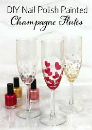 use nail polish to create festive champagne glasses works great with other glass surfaces