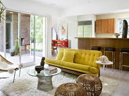 best mid century modern living room furniture ideas featuring white rug and wooden kitchen bar with black leather stools