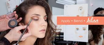 a model receiving make up with to the right the word apply