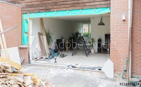 removing a wall and placing a glass sliding door