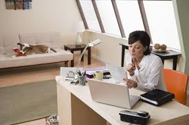 working for home office. Woman Working In Home Office For