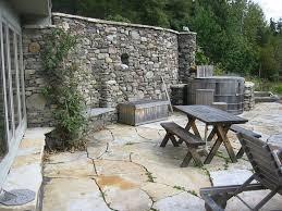 stone retaining wall with stone patio