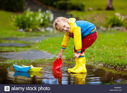 Image result for wearing gumboots and umbrella sailing paper boats