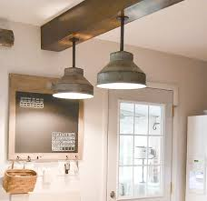 pin this looking to update the lighting in your kitchen these diy light fixtures upcycle farm pieces