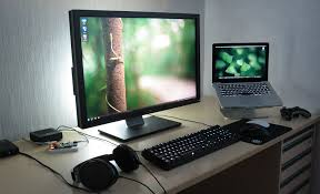 i like the backlit display clean setup mac windows on same desk