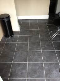 galileo black floor tiles with lighter grey floor grout