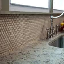 Neutral Penny Tile Backsplash in Traditional Kitchen