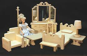 the stephanie doll house plan a classic victorian has a large livingroom 2 bedrooms kitchen bath playroom and attic free plans to help anyone build barbie doll furniture plans