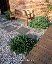 ambience images gravel garden beside the house with wooden bench wooden decking and stepping stones designer mark laurence