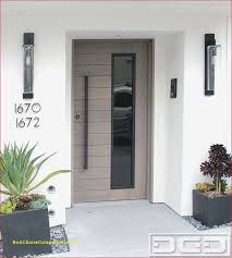 modern entry door in solid white oak with modern pull handle and asymmetrical glass design by