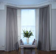 wrought iron pole the most cost effective way to hang curtains on a bay window