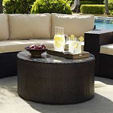 black wicker rattan ottoman coffee table dark brown wood plate for apples and light brown wide wood plate for drink cubes round shaped black wicker rattan