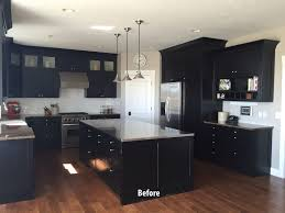 black kitchen cabinets before being painted white