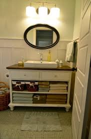 making bathroom cabinets: furniture stupendous oval mirror above washbasin side towel on hanger and nice towels in diy